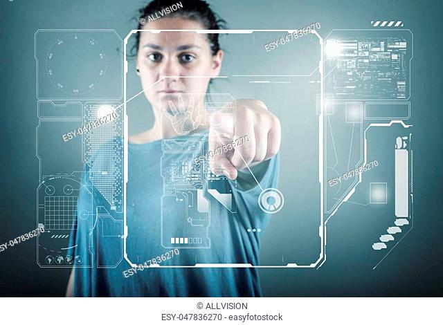 Teenager girl standing and working wth touch screen technology