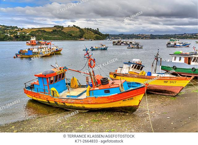 Colorful fishing boats in the harbour in the port of Dalcahue, Chile, South America