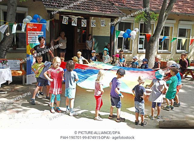 "01 July 2019, Thuringia, Erfurt: Children perform a dance in the AWO kindergarten """"An der schmalen Gera"""". The kindergarten is one of this year's prize winners..."