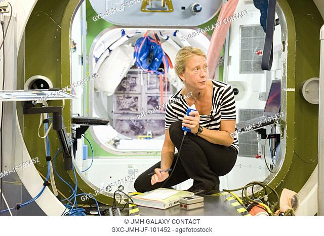 NASA astronaut Karen Nyberg, Expedition 3637 flight engineer, participates in an emergency scenario training session in an International Space Station...