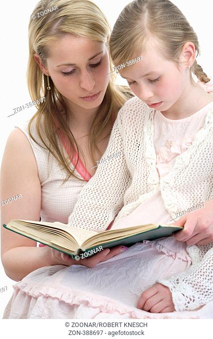 Mother reading to her daughter