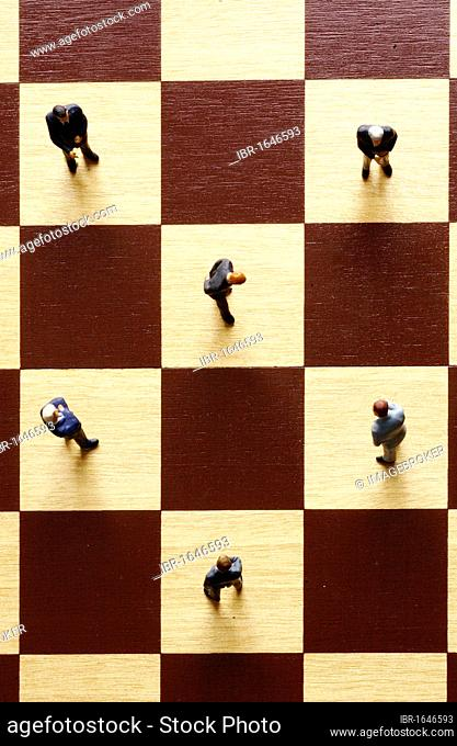 Figurines on a chessboard