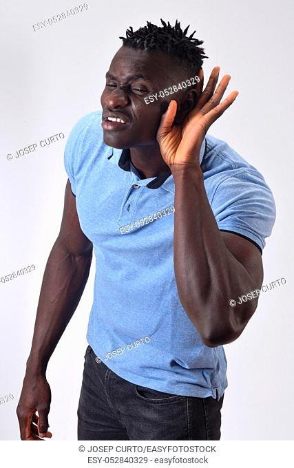 african man putting a hand on her ear because she can not hear on white background