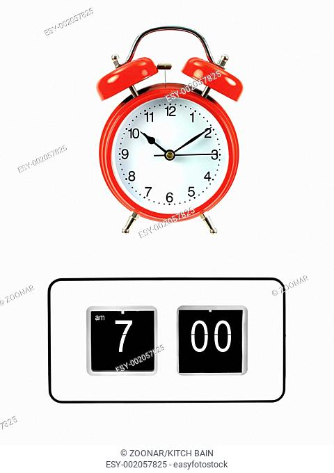 A flip clock isolated against a red background