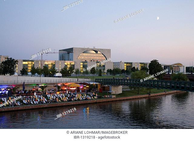 View towards the Federal Chancellery over the Capital Beach Bar on a summer evening on the Spree River, Berlin, Germany, Europe