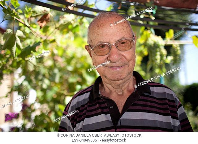 Senior man over 80, portrait in outdoors