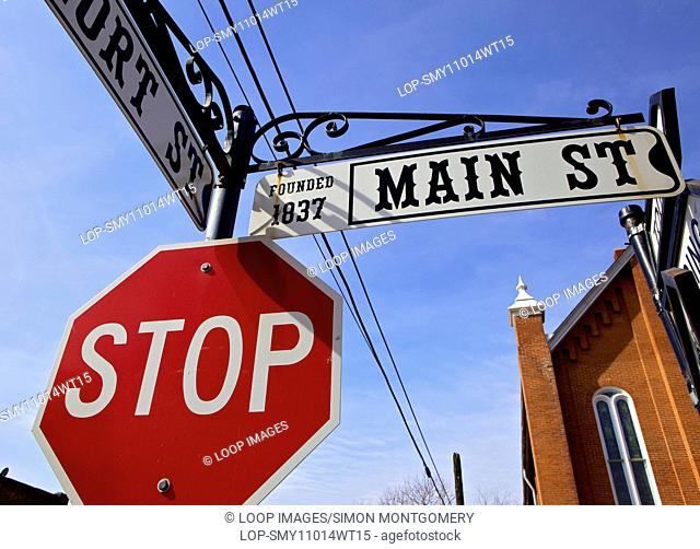 Street signs on Main Street in the historic town of Weston in Missouri