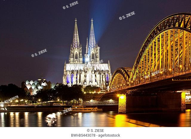 Cologne Cathedral with Hohenzollern Bridge in the night, Germany, North Rhine-Westphalia, Cologne