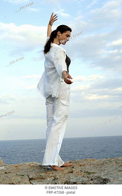 Woman on a rock at the sea