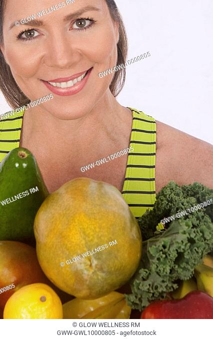 Close-up of a woman with assorted fruits