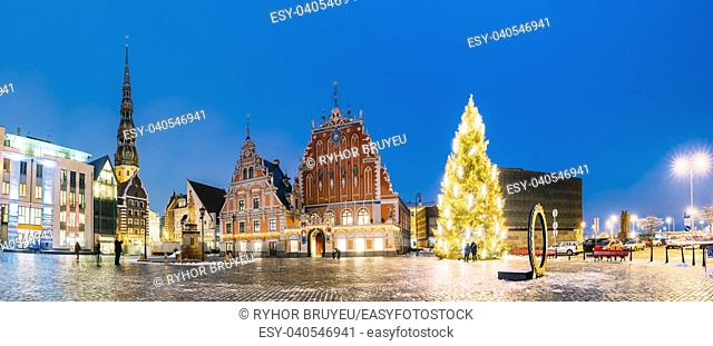 Riga, Latvia. Panorama Of Town Hall Square, Popular Place With Famous Landmarks On It In Bright Evening Illumination In Winter Twilight
