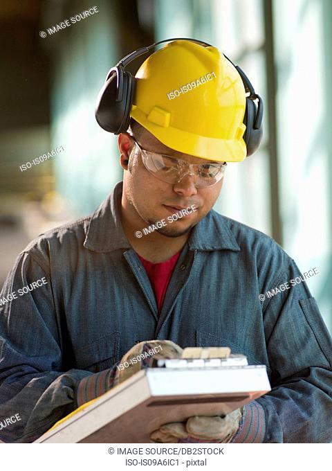 Engineer making notes on site