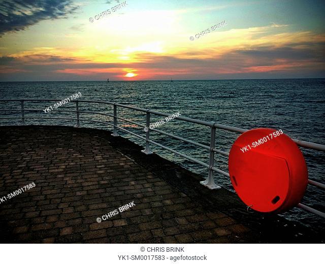 Sunset with lifebuoy in Aberystwyth Wales UK