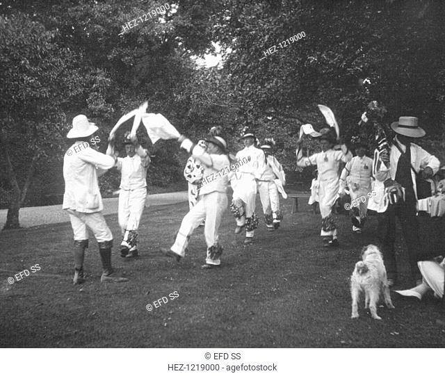 Bampton Morris Dancers, Oxfordshire, Whit Monday, 5 June 1911. William Nathan Wells playing the fiddle; Thomas Tanner, Joseph Rouse