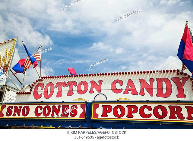 ILLINOIS   Grayslake   Signs atop fast food booth at Lake County Fair for cotton candy, snow cones and popcorn, flags