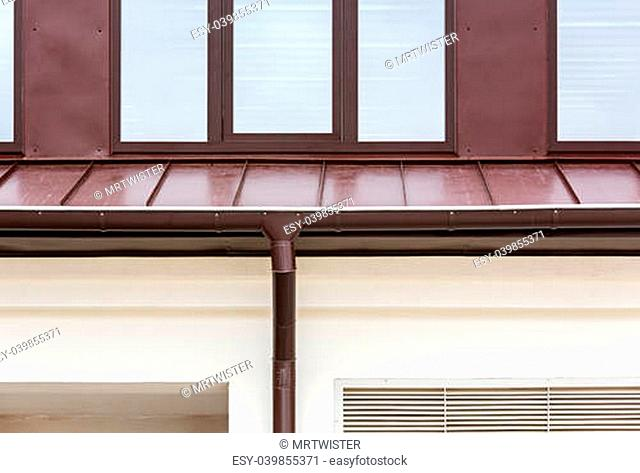 Rain gutter with metal downspout
