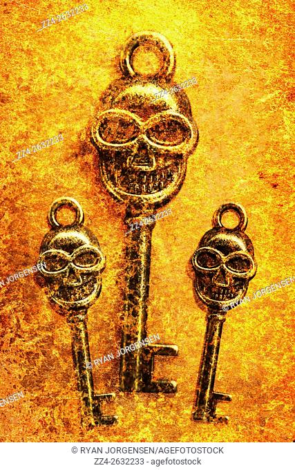 Close-up of scary metal skull shaped keys of different size in flame. Skeleton Keys