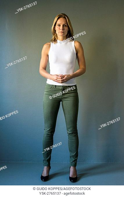 Tilburg, Netherlands. Full body studio portrait of a mid adult caucasian woman