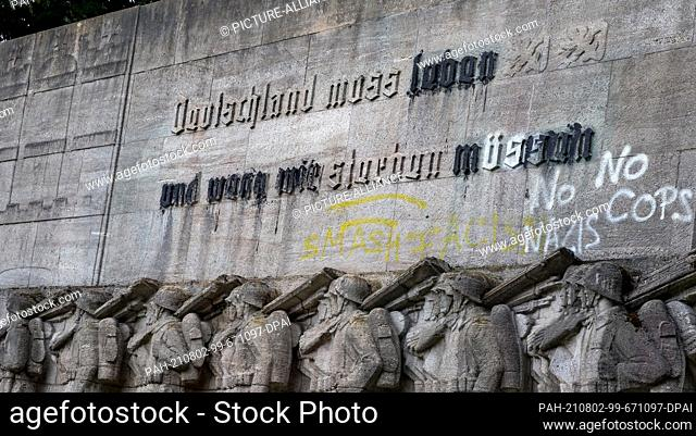 """02 August 2021, Hamburg: The inscription """"""""Germany must live and if we must die"""""""" on the war memorial erected at Dammtor in 1936 was covered over with black..."""