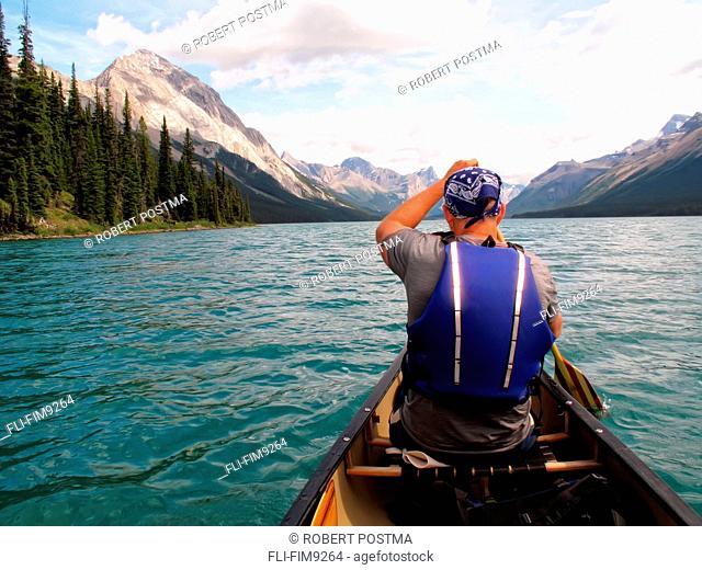 Man canoeing on Maligne Lake, Jasper National Park, Alberta