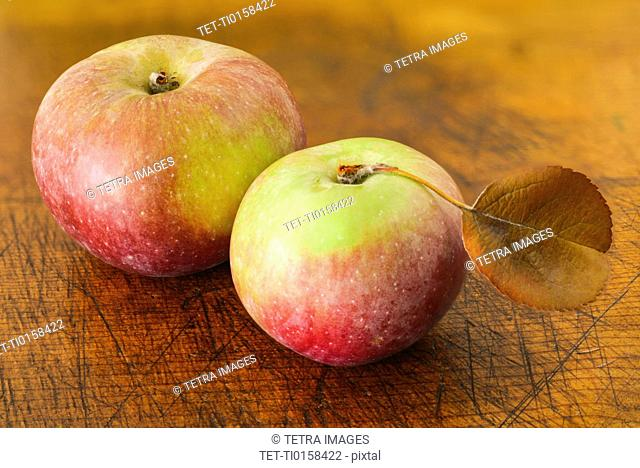 Two apples on wood pattern