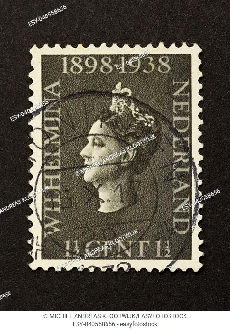 HOLLAND - CIRCA 1950: Stamp printed in the Netherlands shows a picture of the queen (Wilhelmina), circa 1950