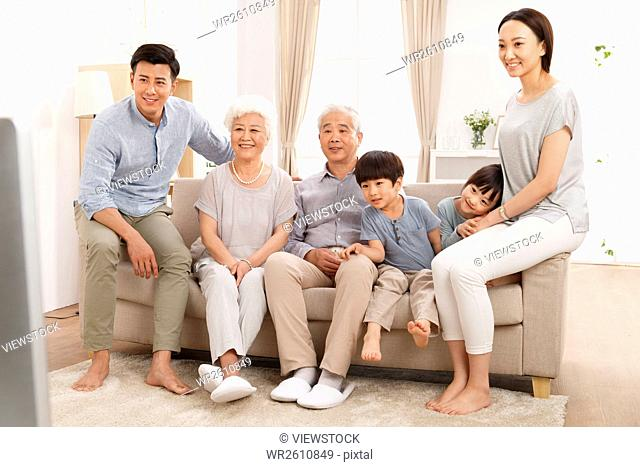Happy family watching TV in the living room