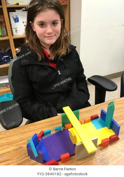 6th Grade Special Education Student Using Building Blocks in Class, Wellsville, New York, USA