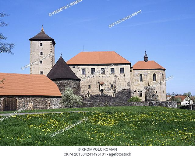 Water Castle Svihov with yellow dandelions in the grass on the foreground. (CTK Photo/Roman Krompolc)
