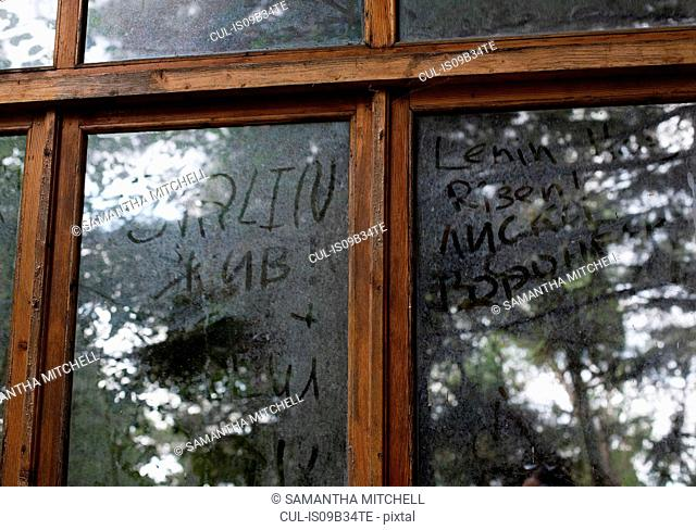 Graffiti written in dirt on window, Sochi, Russia