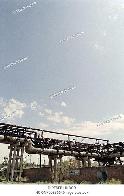 Pipelines in an industry with cloudy sky