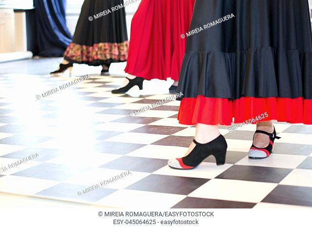 Women dressed and dancing flamenco