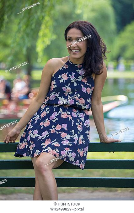 Happy Hispanic woman smiling in a park