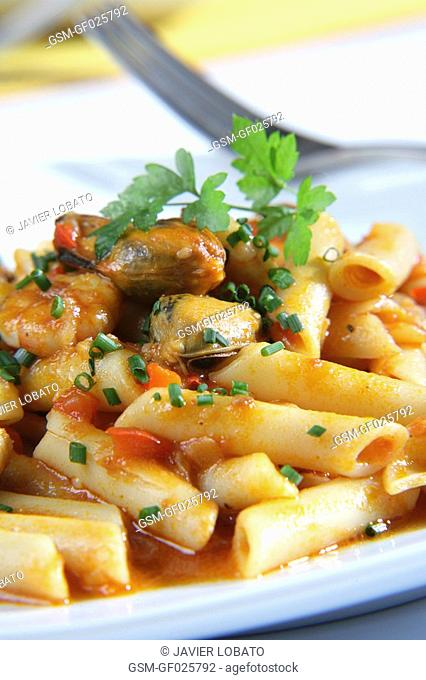 Penne with fish and seafood