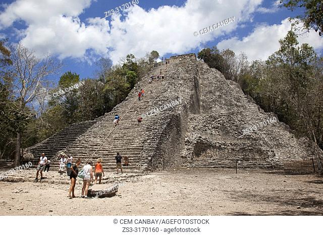 Tourists climbing up the Nohoch Mul Pyramid at the Prehispanic Mayan city of Coba Archaeological Site, Quintana Roo Province, Mexico, Central America