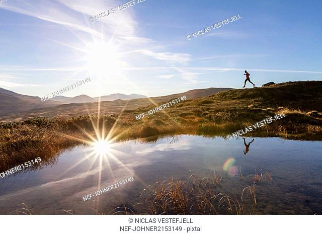 Person running in mountains