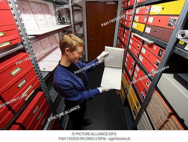 20 May 2019, Hessen, Frankfurt/Main: Susanne Mohr, a student assistant, stands in the written records and photo archive of the new Fassbinder Center of the DFF...