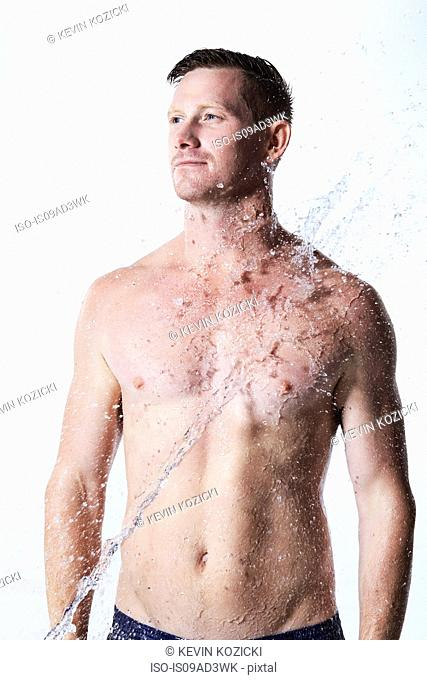 Man with water being splashed on him