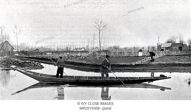 This 1906 photo shows boat transportation in Picardy, a region in northeast France, specifically in the norther area that was mainly farmland