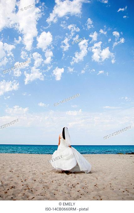 bride walking on beach