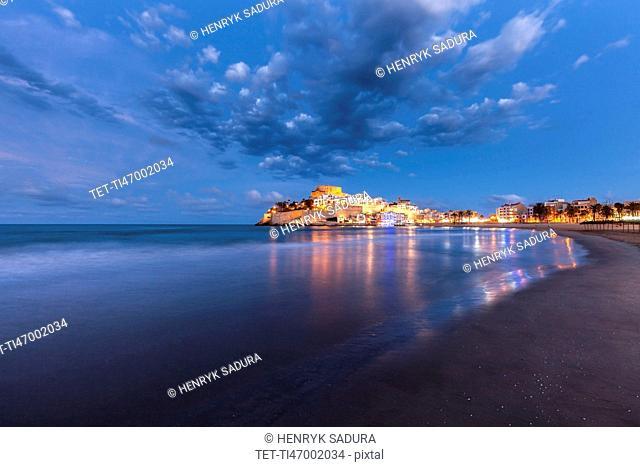 Spain, Valencian Community, Peniscola, Illuminated town by sea