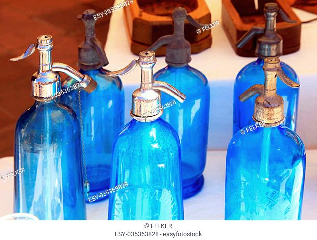 Antique blue soda syphon bottles on flea market , France. Selective focus