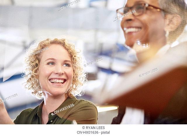 Smiling businesswomen in meeting