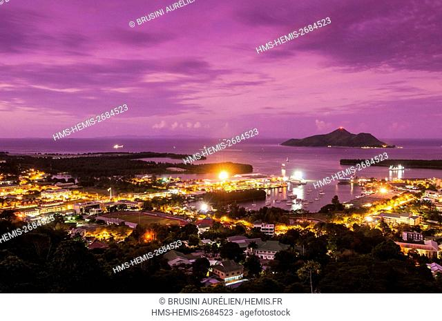 Seychelles, Mahe island, Victoria, the first tuna transhipment port in the Indian Ocean, illuminated at sunset, the island of Sainte Anne in the background