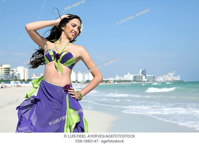 Young woman posing on the beach, Miami Beach, Florida, USA