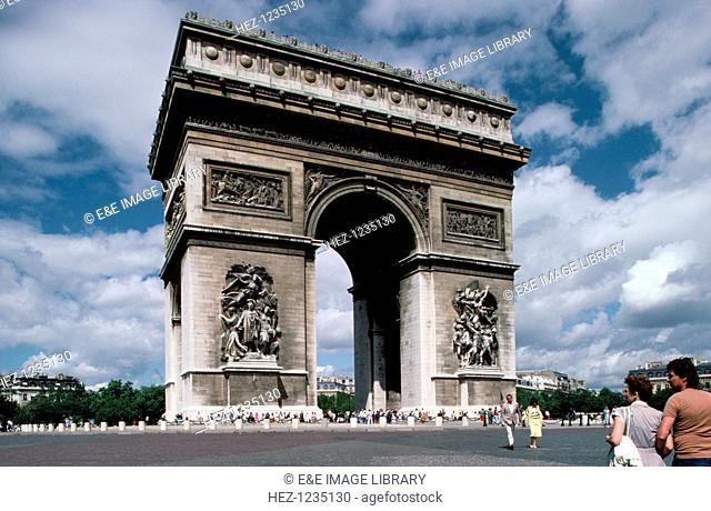 The Arc de Triomphe, Paris. Designed by Jean Chalgrin in Neoclassical style to recall the monumental architecture of Ancient Rome