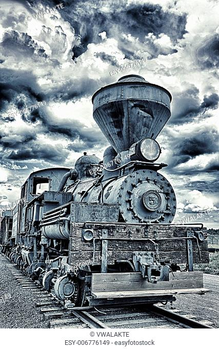 Locomotive number five with dramatic sky