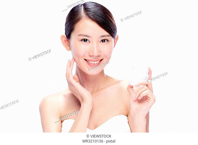 Young woman holding a moisturizer