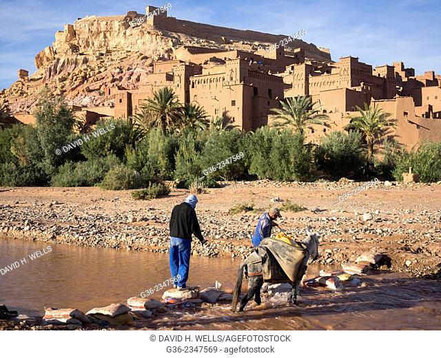 Men with donkey near ancient city of Ait Ben Haddou, Morooco