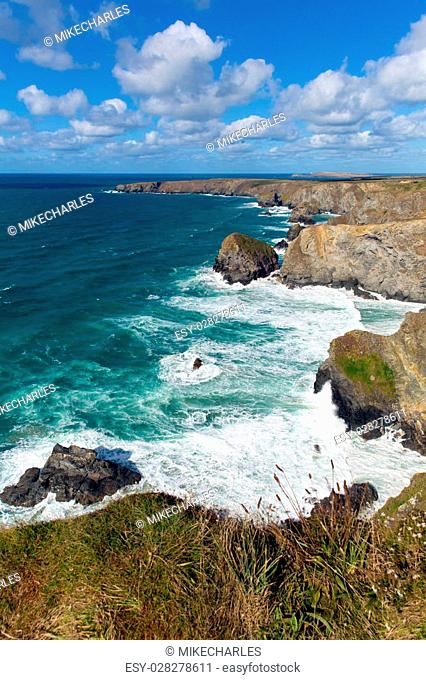 Bedruthan Steps Cornwall England UK Cornish north coast near Newquay on a beautiful sunny blue sky day for this tourist attraction